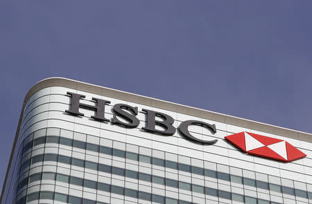 The HSBC logo is seen at their offices at Canary Wharf financial district in London
