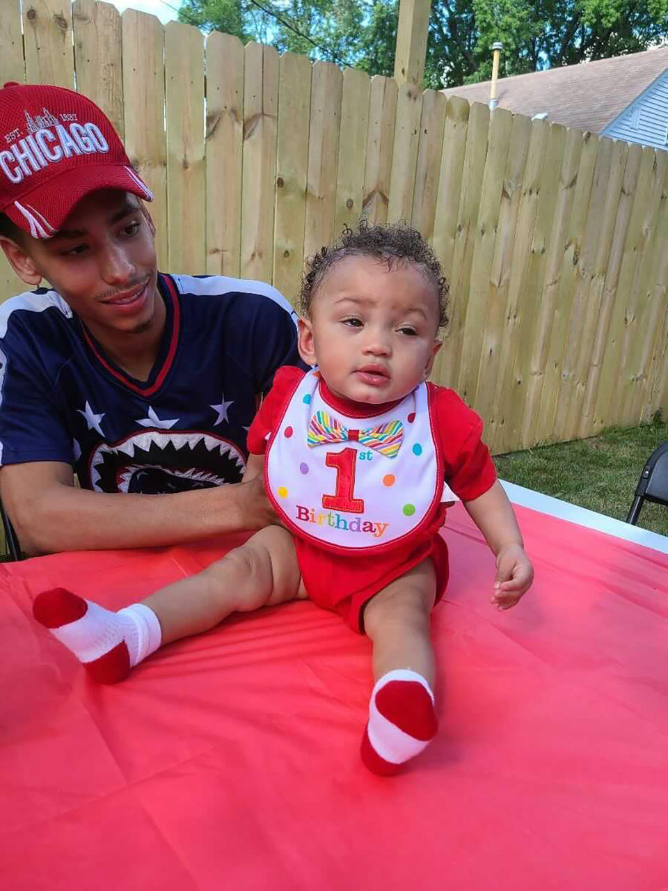 This photo provided by Ben Crump Law, PLLC. shows Daunte Wright and his son Daunte Jr., at his first birthday party. A white police officer who fatally shot Daunte Wright during a traffic stop in a Minneapolis suburb resigned Tuesday, April 13, 2021 as did the city's police chief — moves that the mayor said he hoped would help heal the community and lead to reconciliation after two nights of protests and unrest. (Ben Crump Law, PLLC. via AP)