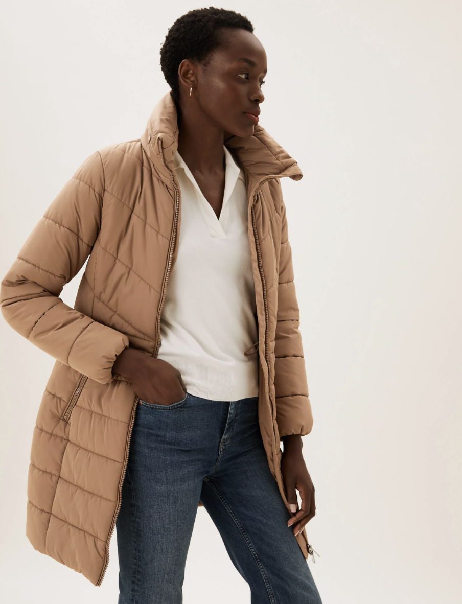 The coat comes in two hue:  blue and beige. (Marks & Spencer)