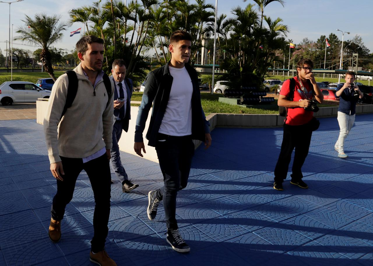 Players of Argentina's River Plate Camilo Mayada (L) and Lucas Martinez Quarta (2nd L) arrive at the South American Football Federation (CONMEBOL) headquarters after they both tested positive for anti-doping controls during two games of the first round of the Copa Libertadores de America, in Luque, Paraguay June 26, 2017.  REUTERS/Jorge Adorno
