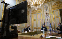 French President Emmanuel Macron, second from right, makes introductory remarks during a visio-conference meeting about support and aid for Lebanon, at the Elysee Palace in Paris, France, Wednesday, Dec. 2, 2020. France is hosting an international video conference on humanitarian aid for Lebanon amid political deadlock in Beirut that has blocked billions of dollars in assistance for the cash-strapped country. (Ian Langsdon, Pool via AP)