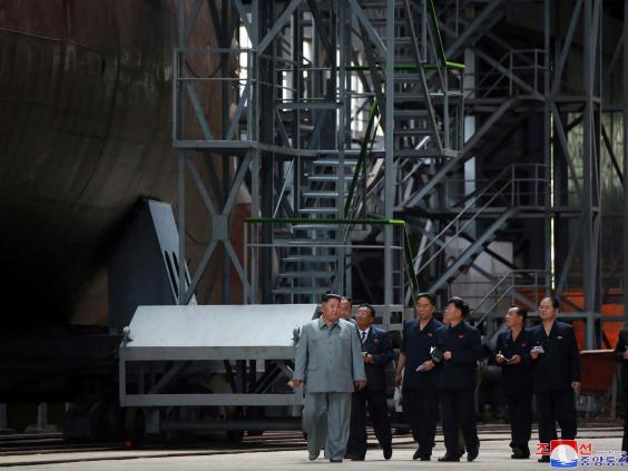Kim Jong Un seen inspecting submarine at an unknown location in North Korea (AP)