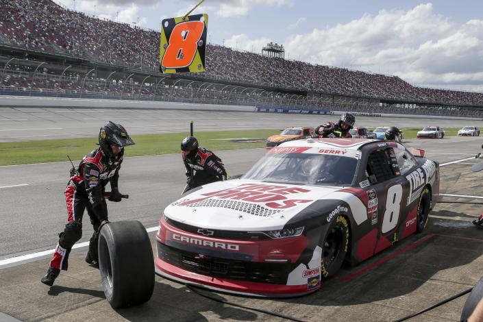 Josh Berry makes a pit stop during the NASCAR Xfinity Series auto race at Talladega Superspeedway on Saturday, April 24, 2021, in Talladega, Ala. (AP Photo/Butch Dill)