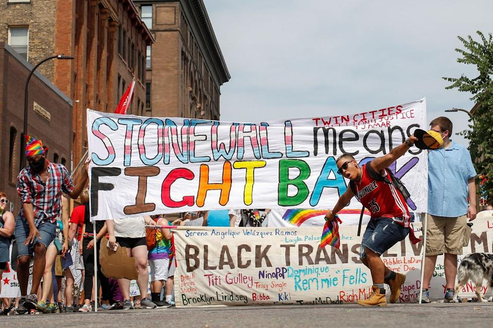 Alex Hamlin dances in front of the Minneapolis Police Department before marching to support the LGBTQ community and the Black Lives Matter movement in Minneapolis, Minnesota, U.S., June 28, 2020.
