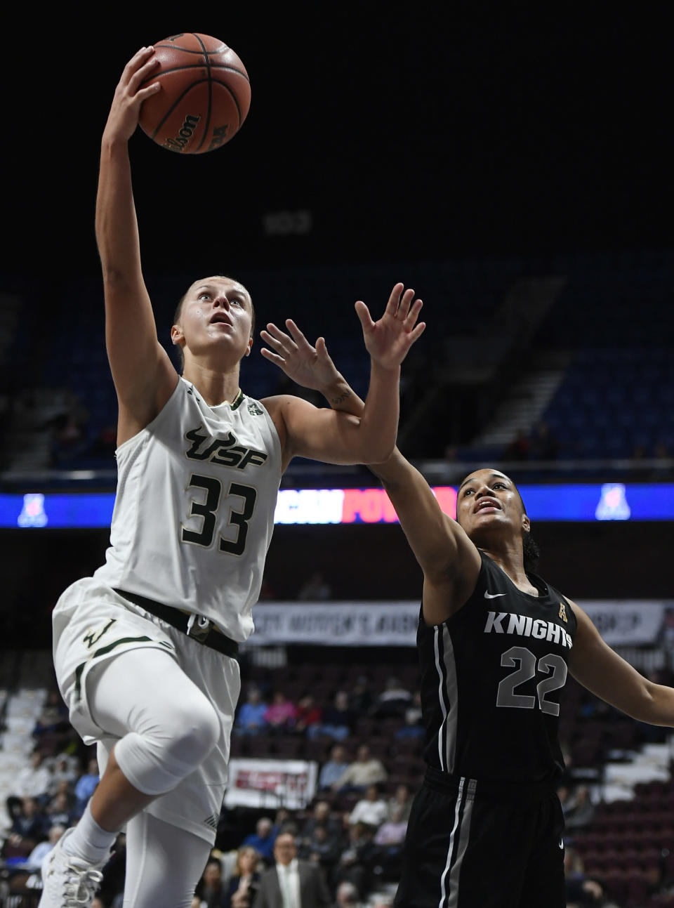 South Florida's Kitija Laksa, left, shoots as Central Florida's Aliyah Gregory, right, defends, during the first half of an NCAA college basketball game in the American Athletic Conference tournament semifinals at Mohegan Sun Arena, Monday, March 5, 2018, in Uncasville, Conn. (AP Photo/Jessica Hill)