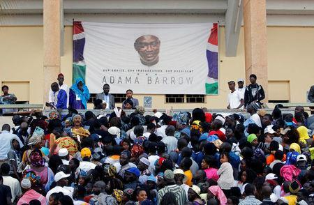 Supporters of Gambian President Adama Barrow arrive for his swearing-in ceremony and the Gambia's Independence Day at the Independence Stadium, in Bakau, Gambia February 18, 2017. REUTERS/Thierry Gouegnon