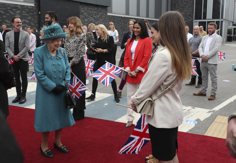 Britain's Queen Elizabeth II meets actors during a visit to the studio of the long running television series Coronation Street, in Manchester, England, Thursday July 8, 2021. (AP Photo/Scott Heppell)