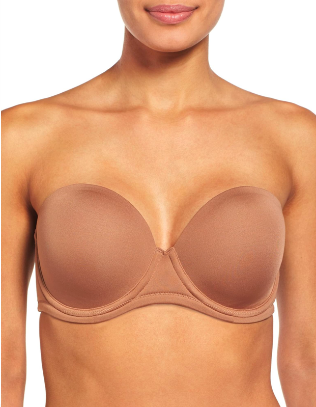 """<p><strong>Key selling points:</strong> With over 1,300 reviews and a near-perfect star rating, this molded underwire bra features smooth fabric and light foam padding to accentuate your natural shape. It comes with removable straps that can be worn conventionally, halter style, or crossed in the back, making it the perfect match for your favorite <a href=""""https://www.glamour.com/gallery/best-white-tank-tops?mbid=synd_yahoo_rss"""" rel=""""nofollow noopener"""" target=""""_blank"""" data-ylk=""""slk:summer tanks"""" class=""""link rapid-noclick-resp"""">summer tanks</a>.</p> <p><strong>What customers say:</strong> """"This is hands-down the best-fitting, most comfortable, non-slipping, best shaped strapless bra you will ever find! I have tried so many over the years and all have been annoying and ill-fitting! This one works like I expected the style to work, and The Anniversary Color this year is practically invisible on my light olive skin—so glad I added another one to my collection. I wear it under all my racerback tanks and all my shoulder cut-in tops. Works beautifully! I can wear it all day and not have to adjust even once. So happy with this bra—you need it in your wardrobe!"""" —<em>Maryannsandiego, Reviewer on</em> <a href=""""https://click.linksynergy.com/deeplink?id=3r4YdkDiq/o&mid=1237&u1=BestStraplessBras&murl=https%3A%2F%2Fwww.nordstrom.com%2Fs%2Fwacoal-red-carpet-convertible-strapless-bra%2F5650501"""" rel=""""nofollow noopener"""" target=""""_blank"""" data-ylk=""""slk:Nordstrom"""" class=""""link rapid-noclick-resp""""><em>Nordstrom</em></a></p> $68, Nordstrom. <a href=""""https://www.nordstrom.com/s/wacoal-red-carpet-convertible-strapless-bra/3236610"""" rel=""""nofollow noopener"""" target=""""_blank"""" data-ylk=""""slk:Get it now!"""" class=""""link rapid-noclick-resp"""">Get it now!</a>"""