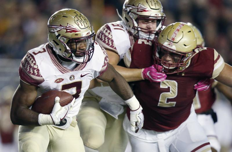 FILE - In this Oct. 27, 2017, file photo, Florida State running back Cam Akers (3) carries the ball as Boston College defensive end Zach Allen (2) defends during the second half of an NCAA college football game in Boston. The sophomore had four 100-yard games last season along with setting Florida State's freshman rushing record with 1,025 yards. Akers will be counted on early to be a focal point of Taggart's offense, starting with the Sept. 3 opener against Virginia Tech. (AP Photo/Michael Dwyer, File)