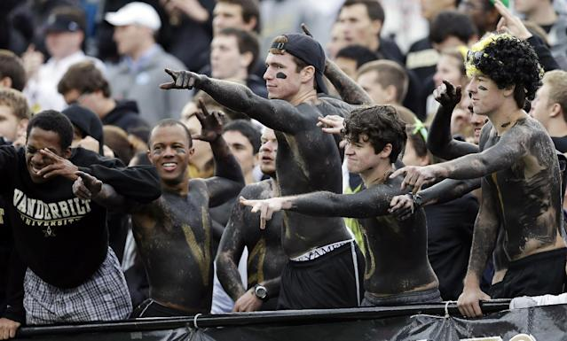 Vanderbilt fans cheer in the fourth quarter of an NCAA college football game between Vanderbilt and Georgia on Saturday, Oct. 19, 2013, in Nashville, Tenn. Vanderbilt upset No. 15 Georgia 31-27. (AP Photo/Mark Humphrey)