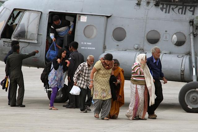 "In this photograph received from the Ministry of Defence on June 20, 2013, rescued flood evacuees alight from an Indian Air Force Mi-17 helicopter following flash floods in the northern Uttarakhand state. India's military battled on June 20 to reach villages and towns cut off by flash floods and landslides in the country's north as officials warned at least 1,000 people may have been killed. AFP PHOTO/INDIAN ARMY ----EDITORS NOTE---- RESTRICTED TO EDITORIAL USE - MANDATORY CREDIT - ""AFP PHOTO/INDIAN ARMY"" - NO MARKETING NO ADVERTISING CAMPAIGNS - DISTRIBUTED AS A SERVICE TO CLIENTS -----"
