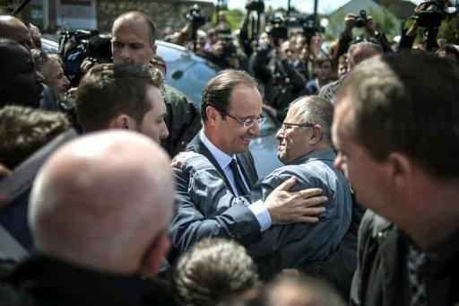 France's Socialist Party (PS) candidate for the 2012 French presidential election Francois Hollande greets supporters as he arrives for a campaign meeting, in Nevers, central France. Hollande said he would seek to be a successor to France's last Socialist president Francois Mitterrand and accused Nicolas Sarkozy of trying to divide France with his attacks on trade unions