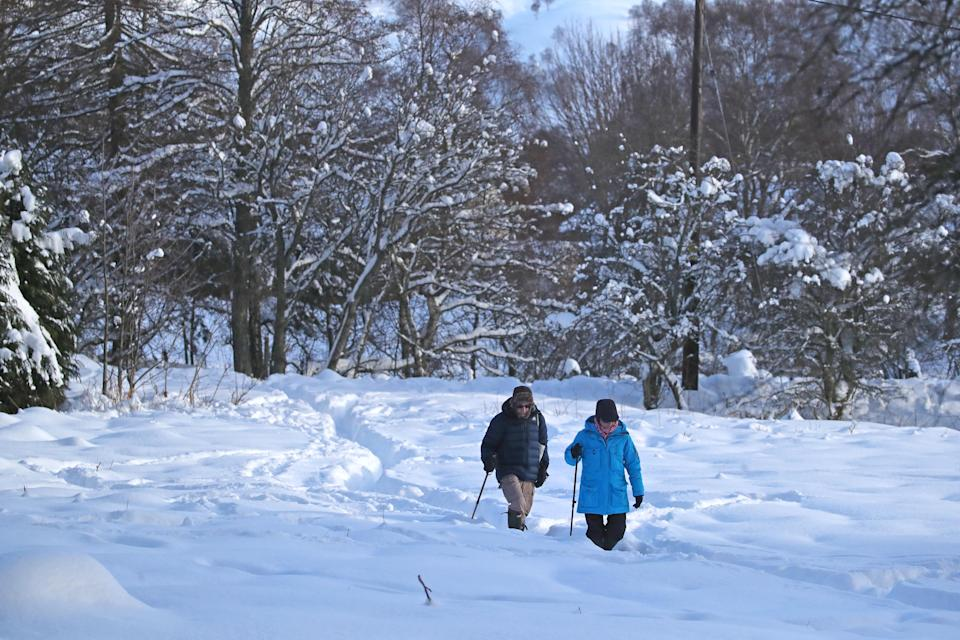 People walking in snowy conditions in Braemar, Aberdeenshire, which had an overnight temperature of minus 23.0C (minus 9.4F). The village, which is near Balmoral Castle, the summer residence of Queen Elizabeth II, recorded the lowest temperature in the UK in more than two decades, following an