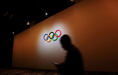 A man walks past the Olympic Rings as he walks out of the 133rd International Olympic Committee (IOC) session in Buenos Aires, Argentina October 8, 2018. REUTERS/Marcos Brindicci