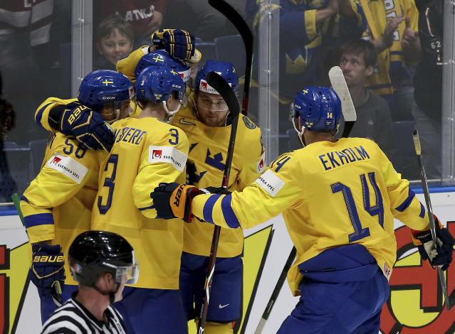 Sweden players celebrate after scoring during the Ice Hockey World Championships group B match between Sweden and Latvia at the Ondrej Nepela Arena in Bratislava, Slovakia, Monday, May 20, 2019. (AP Photo/Ronald Zak)