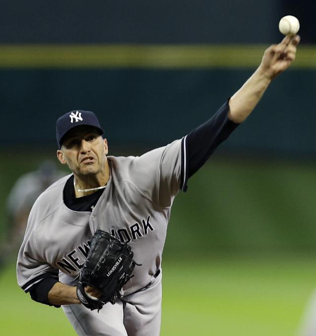 New York Yankees starting pitcher Andy Pettitte throws during the first inning of a baseball game against the Houston Astros Saturday, Sept. 28, 2013, in Houston. (AP Photo/David J. Phillip)