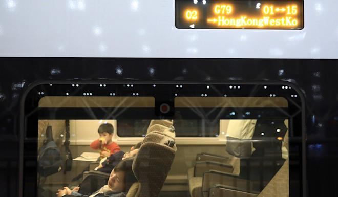 Passengers on a high-speed train from Beijing to Hong Kong, which stopped in Wuhan but did not let any passengers board. Photo: May Tse