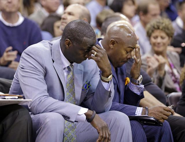 Utah Jazz's head coach Tyrone Corbin, left, lowers his head late in the fourth quarter during an NBA basketball game against the Los Angeles Lakers Monday, April 14, 2014, in Salt Lake City, Utah. The Lakers won 119-104. (AP Photo/Rick Bowmer)