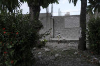 An injured boy walks through the yard of the Immaculée Conception hospital in Les Cayes, Haiti, Sunday, Aug. 22, 2021, eight days after a 7.2 magnitude earthquake hit the area. (AP Photo / Matias Delacroix)