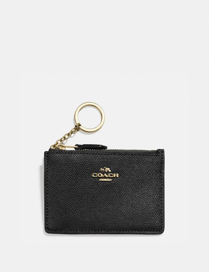 <p>Keep your keys and other essentials secure with this <span>Mini Skinny Id Case</span> ($65).</p>