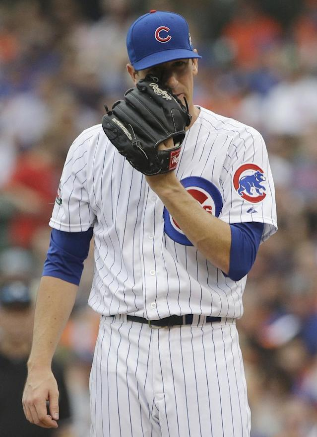 Chicago Cubs starter Kyle Hendricks wipes his face during the second inning of an interleague baseball game against the Baltimore Orioles in Chicago, Saturday, Aug. 23, 2014. (AP Photo/Nam Y. Huh)