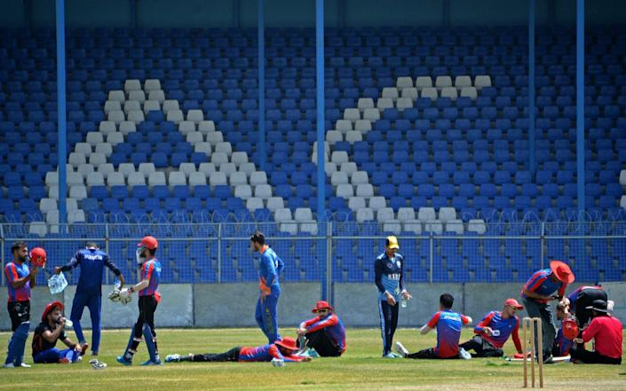 Afghanistan's national cricket team players attend a training session at the Kabul International Cricket Ground in Kabul, ahead of their one-day series against Pakistan, scheduled to take place in Sri Lanka in two weeks. - GETTY IMAGES
