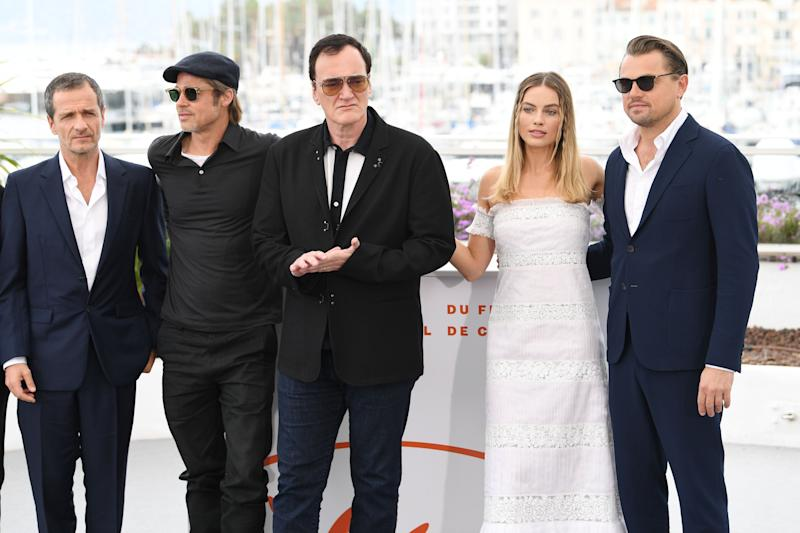 "CANNES, FRANCE - MAY 22: David Heyman, Brad Pitt, Director Quentin Tarantino, Margot Robbie and Leonardo DiCaprio attend the photocall for ""Once Upon A Time In Hollywood"" during the 72nd annual Cannes Film Festival on May 22, 2019 in Cannes, France. (Photo by Daniele Venturelli/WireImage)"