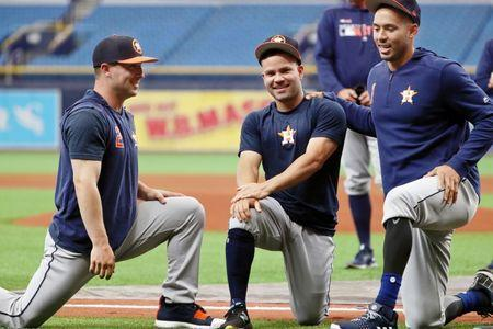 Mar 28, 2019; St. Petersburg, FL, USA; Houston Astros third baseman Alex Bregman (2), second baseman Jose Altuve (27) and shortstop Carlos Correa (1) stretch prior to opening day against the Tampa Bay Rays at Tropicana Field. Mandatory Credit: Kim Klement-USA TODAY Sports