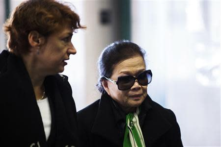 Vilma Bautista (R), the ex-secretary of former Philippine first lady Imelda Marcos, arrives for sentencing at Manhattan Supreme Court in New York, January 13, 2014. Bautista is being sentenced in the New York court after she was found guilty of conspiracy in the attempted sale of a Monet painting and other valuable artworks. REUTERS/Lucas Jackson
