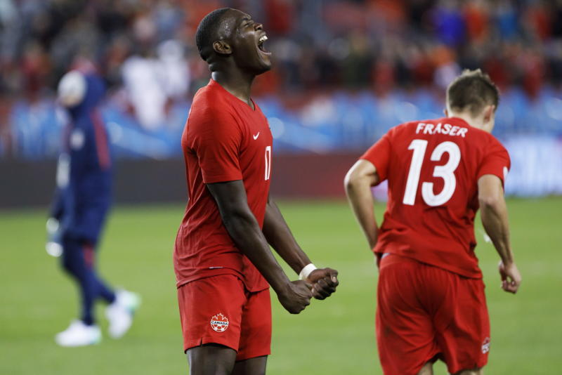 Canada defender Kamal Miller (17) reacts at the end of Canada's victory over the United States in a CONCACAF Nations League soccer match Tuesday, Oct. 15, 2019, in Toronto. (Cole Burston/The Canadian Press via AP)