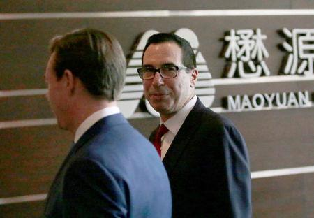 U.S. Treasury Secretary Steven Mnuchin is seen as he and a U.S. delegation for trade talks with China arrive at a hotel in Beijing