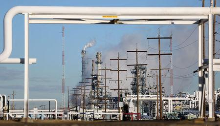 FILE PHOTO - Steam from a Suncor refinery rises at rear as pipes are seen traversing industrial zones run by energy firms Enbridge and Kinder Morgan in Sherwood Park