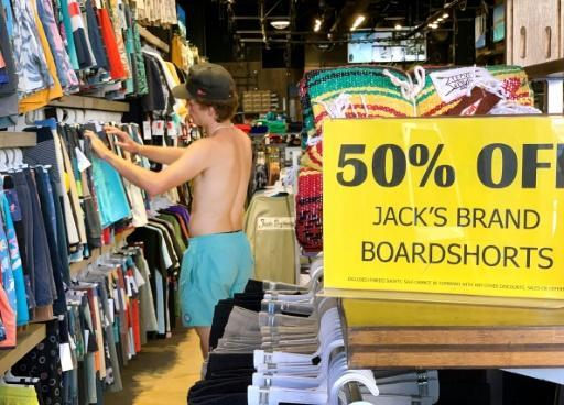 A man shops in a California surf store without a mask on July 16, 2020, disregarding a state mask-wearing mandate