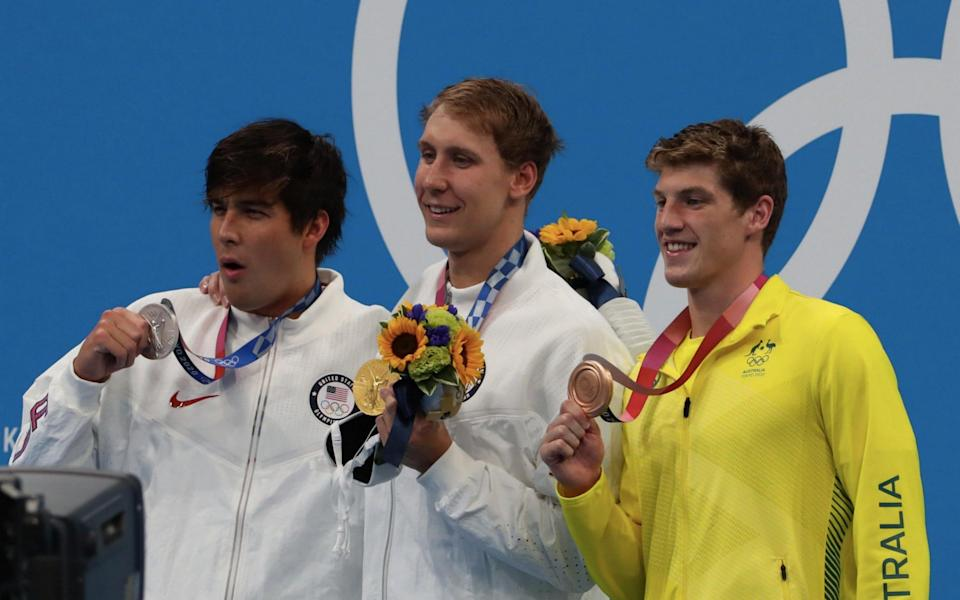 Chase Kalisz of United States celebrate his gold medal with Jay Litherland and Bredon Smith of Austrlia after the Men's 400m individual medley on day two - Xavier Laine/Getty Images