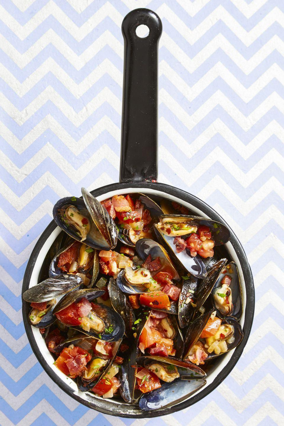 """<p>We bet you never thought of tossing a batch of frozen French fries into a pot of mussels ... until now.</p><p><em><a href=""""https://www.goodhousekeeping.com/food-recipes/easy/a44750/spicy-italian-mussels-frites-recipe/"""" rel=""""nofollow noopener"""" target=""""_blank"""" data-ylk=""""slk:Get the recipe for Spicy Italian Mussels and &quot;Frites&quot; »"""" class=""""link rapid-noclick-resp"""">Get the recipe for Spicy Italian Mussels and """"Frites"""" »</a></em></p>"""