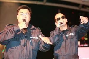Two emcees dressed as PUB servicemen