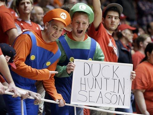 Utah fans display a sign during the first half of an NCAA college basketball game against Oregon on Saturday, March 9, 2013, in Salt Lake City. Utah defeated Oregon 72-62. (AP Photo/Rick Bowmer)