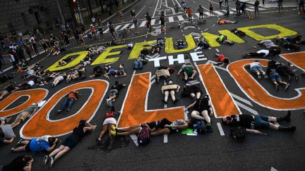 PHOTO: Demonstrators lie on the pavement during a peaceful protest against police brutality and racism, June 6, 2020, in Washington, DC. (Brendan Smialowski/AFP via Getty Images)