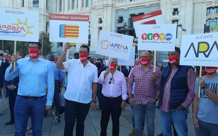 Owners of restaurants and cafes affected by coronavirus (Covid-19), gather to stage a protest due to pandemic in Madrid, Spain on September 09, 2020. - Anadolu Agency