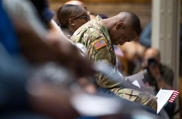<p>U.S. Army Specialist Shane Cardel, of Jamaica, bows his head after taking the Naturalization Oath of Allegiance to the United States of America Friday, June 30, 2017, during a naturalization ceremony at the New York Public Library in New York. Over 190 immigrants from 59 countries became American citizens at the fourth annual Independence Day naturalization ceremony hosted by the library. (Photo: Michael Noble Jr./AP) </p>