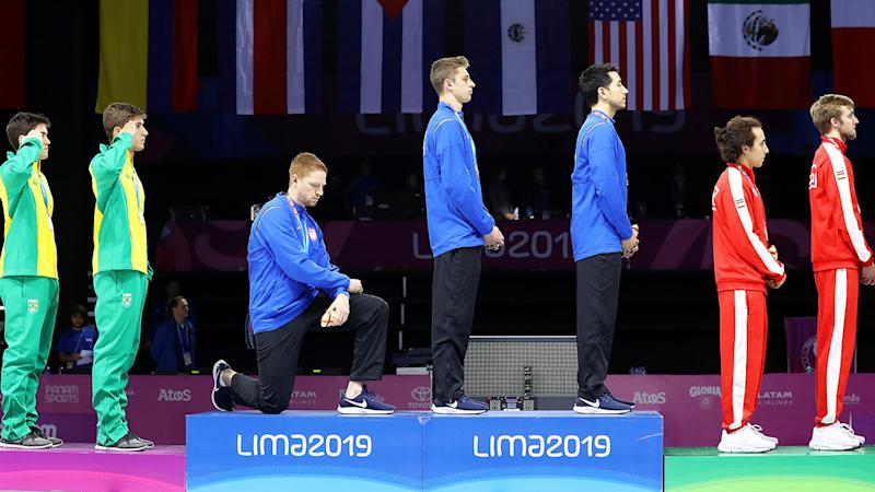 Race Imboden of the United States takes a knee during the national anthem at the Pan America Games. (Photo by Leonardo Fernandez/Getty Images)