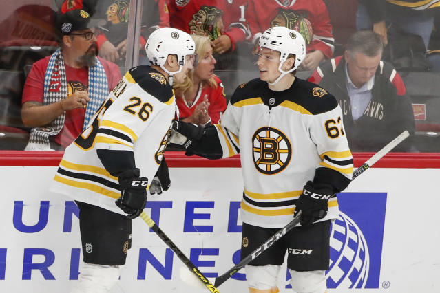 Boston Bruins center Oskar Steen, right, celebrates with center Par Lindholm, left, after scoring against the Chicago Blackhawks during the third period of a preseason NHL hockey game Saturday, Sept. 21, 2019, in Chicago. (AP Photo/Kamil Krzaczynski)