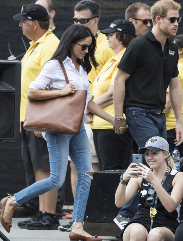The royal couple were spotted holding hands at the Invictus Games tennis match [Photo: Getty]