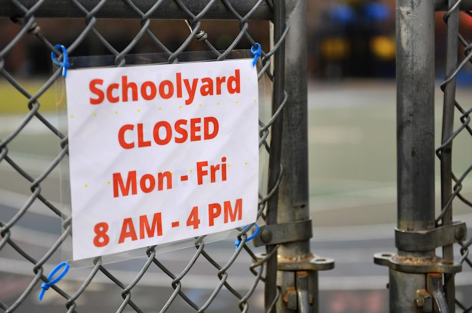 A schoolyard is closed outside a public school in the Brooklyn borough of New York City on November 19, 2020. - US coronavirus deaths passed a quarter of a million people on November 18 as New York announced it would close schools to battle a rise in infections. (Photo by Angela Weiss / AFP) (Photo by ANGELA WEISS/AFP via Getty Images)