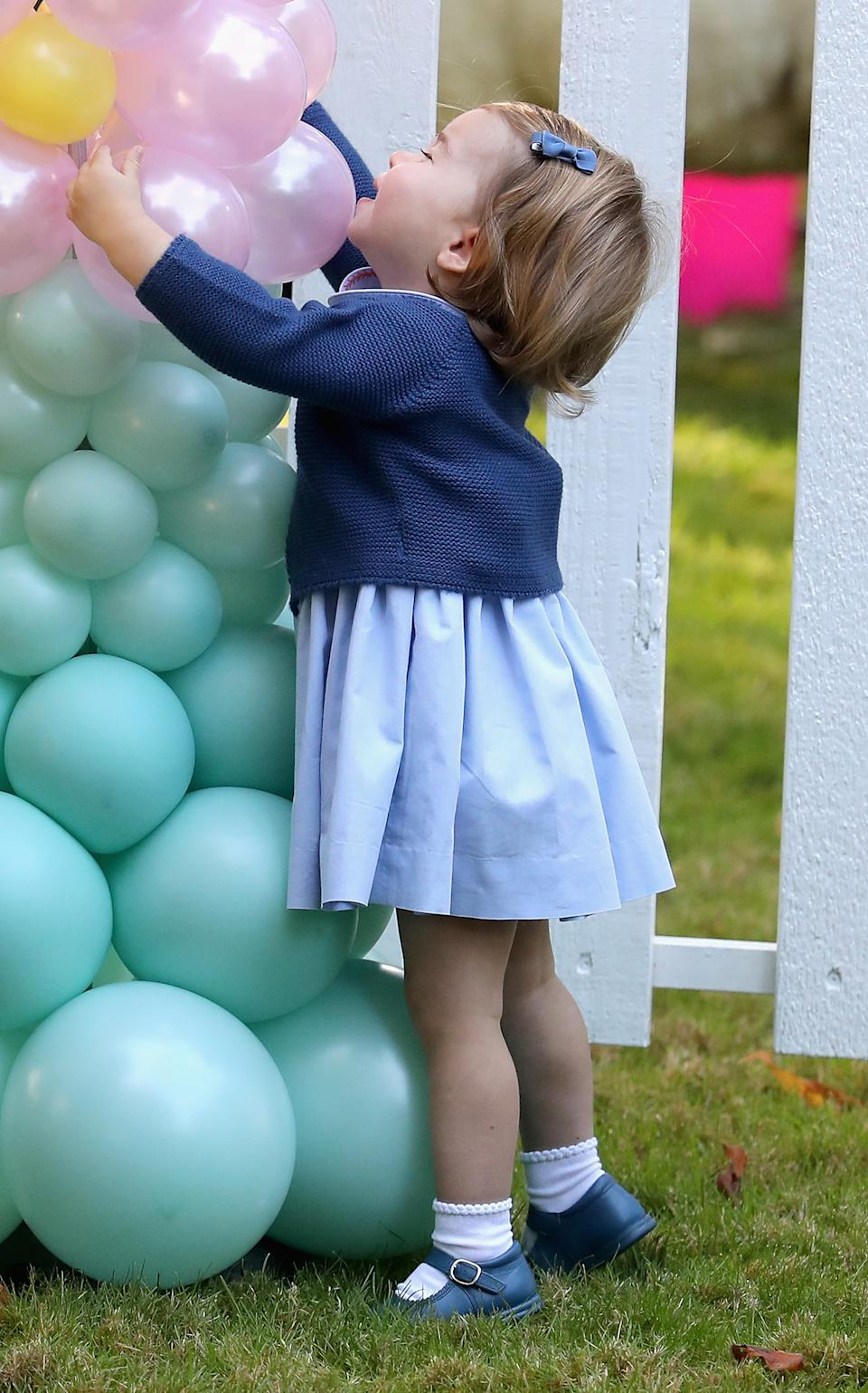 <p>There was a lot going on at this children's party during the 2016 royal tour to Canada, but Charlotte discovering balloons has got to be a highlight. (Chris Jackson - Pool/Getty Images)</p>