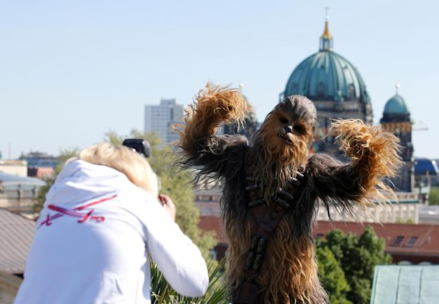"A person dressed up as Chewbacca character poses during a photocall to promote the new Star Wars Movie ""Solo: A Star Wars Story"" in Berlin, Germany, May 4, 2018. REUTERS/Axel Schmidt"