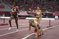 Emma Coburn, of the United States, falls in the final of the women's 3,000-meters steeplechase at the 2020 Summer Olympics, Wednesday, Aug. 4, 2021, in Tokyo. (AP Photo/Matthias Schrader)