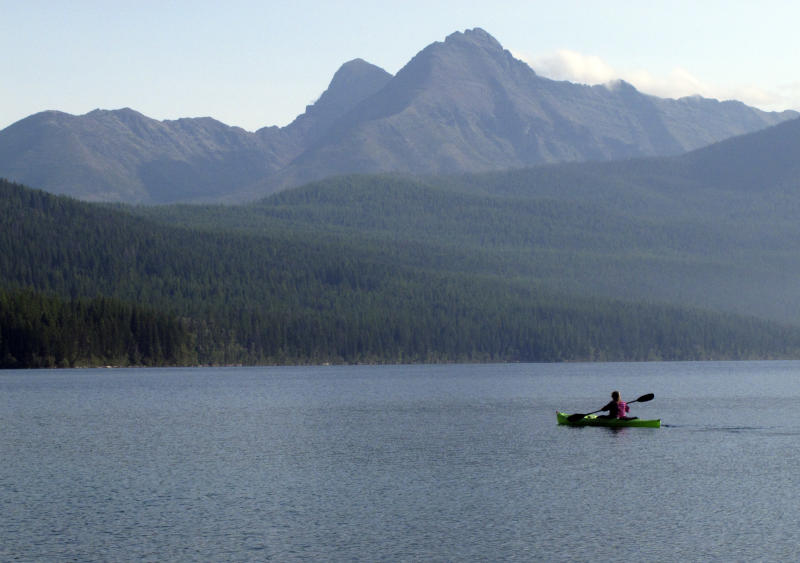This Sept. 6, 2013, photo shows Ingrid Forsmark kayaking on Kintla Lake in Glacier National Park, Mont. Forsmark says she returns to the remote lake near the Canadian border because of its manager, Lyle Ruterbories. He is the National Park Service's oldest ranger at age 93. (AP Photo/Matt Volz)