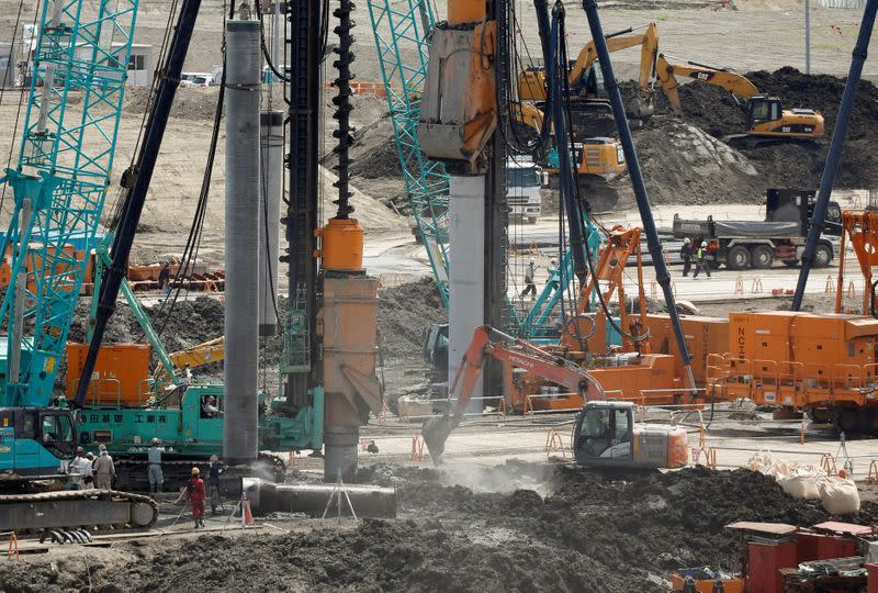 Heavy machines are seen at a construction site in Tokyo