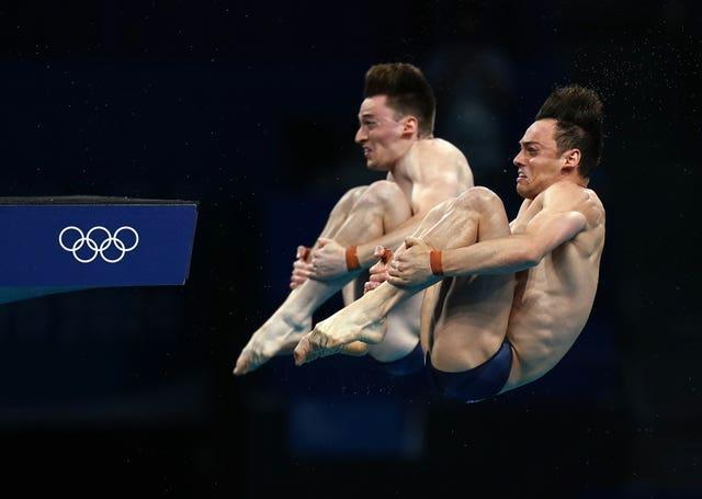 Matty Lee, left, and Tom Daley took Tokyo 2020 gold in the men's synchronised 10 metres platform (Adam Davy/PA)